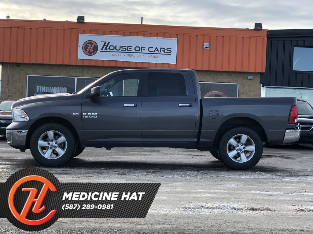 Pre-Owned 2016 Ram 1500 4WD Crew Cab 140.5 SLT