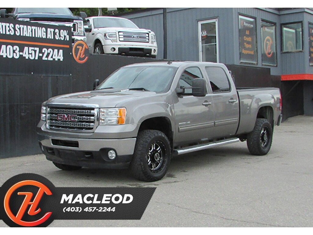 Pre-Owned 2013 GMC SIERRA 2500HD SLT,Leather,Heated Seats,Back up cam,AWD