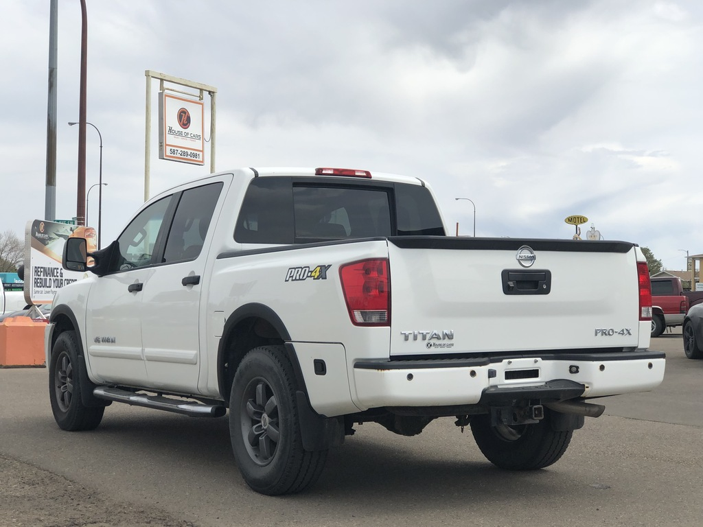 Pre-Owned 2013 Nissan Titan 4WD Crew Cab SWB PRO-4X