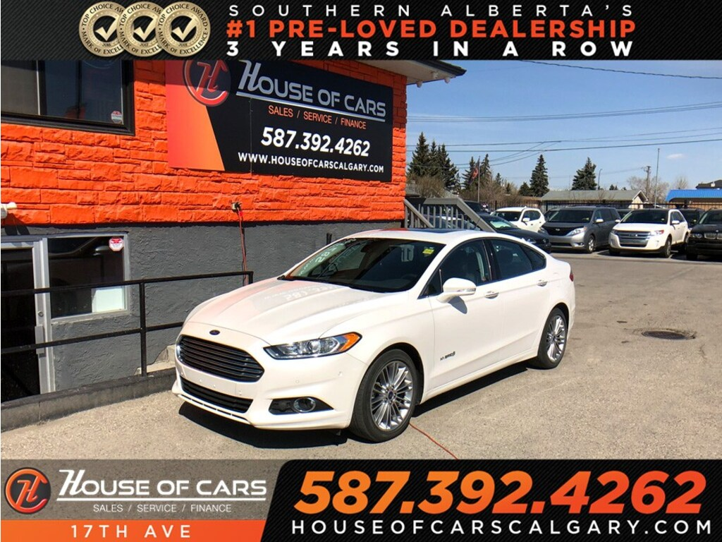 Pre-Owned 2014 Ford Fusion Hybrid SE / Navi / Leather / Sunroof / 2 sets of wheels